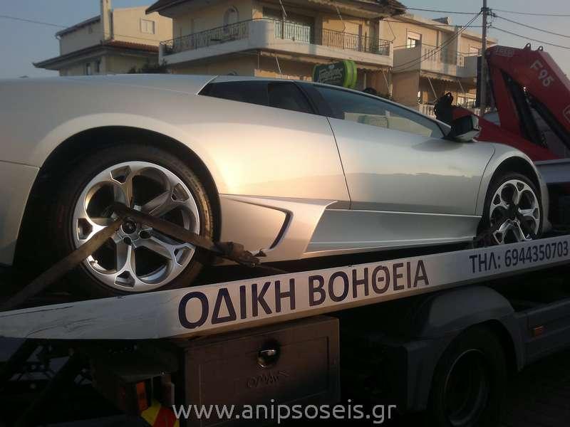 οδική βοήθεια, Νίκος Θωμόπουλος - μεταφορά αυτοκινήτου